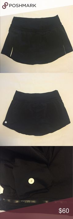 Lululemon Pace skirt Sz 4 black NWOT Lululemon pace skirt  Sz 4 Black . great for tennis and running has reflector strips on front of skirt . Hidden pockets , stay put  rubber on inside of legs . No tear tag dot 4 lululemon athletica Shorts