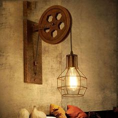 Add warmth and light to your home with a remarkable vintage pulley wall mounted lamp! Made from plated iron. Lamp base measures approximately Lamp cage measures approximately x Power Source: AC Voltage: 110 - Energy saving lamp! Pulley Wall Light, Wall Lamp, Wall Lights, Vintage Wall Lights, Wall Mounted Lamps, Rustic Lamps, Retro Lamp, Corridor Lighting, Modern Lamp