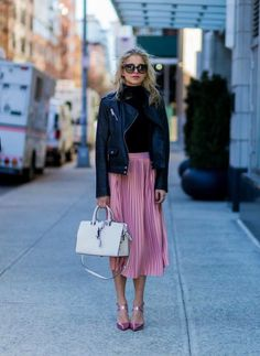 justthedesign: Caroline Daurshows us a cute and pretty way to wear the pleated skirt trend pairing this pink midi skirt with a polo neck top and a cropped leather jacket. Pullover: Vila via Edited Jacket: Edited Skirt/Shoes: Asos Bag: YSL.