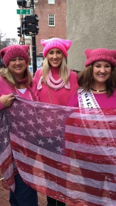 For the Women's March on Washington on Saturday, there was a very specific uniform: layers to keep warm, a witty sign, and a pink pussy hat. Thanks to the Pussy Hat Project, which launched in November to encourage knitters to make pink cat-eared hats, protesters around the world — from Washington, D.C., where more than half a million people have gathered, to Tbilisi, Georgia — are united in fashion. Click through above for the best pink hats spotted at marches everywhere. Follow us on…