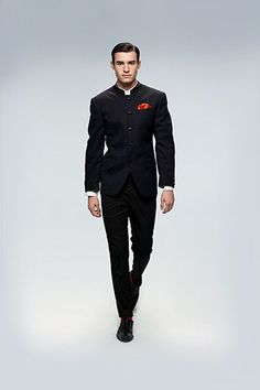 A classic black bandhgala with a red pocket square. Shop for your wedding trousseau , with a personal shopper & stylist in India - Bridelan, visit our website www.bridelan.com #Bridelan #Indiangroom