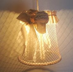 Pendant lamp crafted from a wire trash bin.