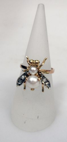 Rose gold, pearl and diamond fly ring from Beaut at Grays