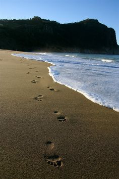 Footprints in the sand by J.H.