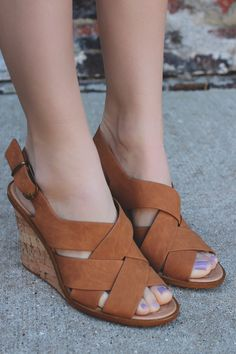 Bora Bora Wedges from UOI Boutique are a pair of faux leather, criss cross front wedges have a buckled ankle strap and cork wedge, perfect for sunset strolls by the beach.