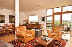 House Profile: Artistic Legacy in Ancram , NY -  Floor-to-ceiling glass frames the north view, allowing lots of natural light into the residence. This is the former home of modern English sculptor Anthony Caro, now home to large-scale clay artist, Paul Chaleff. He and his wife, Haesook Kim, an author and professor, decorated it themselves, balancing Eastern and Western influences with quiet simplicity, (photo: Deborah DeGraffenreid)