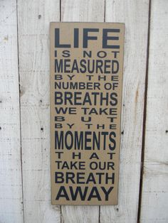 Life is not measured by the number of breaths we take - typography wood word art sign