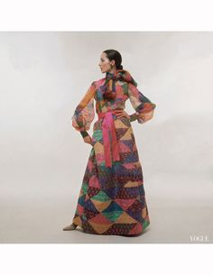 model-wearing-an-yves-saint-laurent-gypsy-style-outfit-of-a-silk-organza-floral-shirt-and-a-long-quilt-like-skirt-and-a-pink-ribbon-fastened-around-the-waist-bert-stern