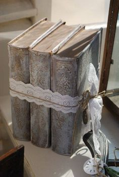 So vintage - old manuscripts nicely displayed (tied with lace ribbon). #books #chic