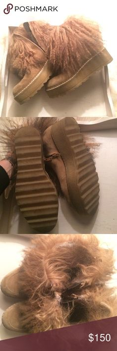Size 7 fur bootie platform Size 7. Platform rubber, fur inside boot and ostrich outside boot.  Zipper inner.  Tan. Worn slightly. Elena Shoes Ankle Boots & Booties