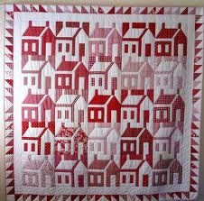 Red and white houses - I like them without the sashing between the blocks - it looks like a town