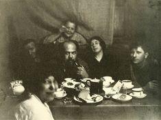 Left to right: Anton Lavinsky, Olga Rodchenko (Alexander Rodchenko's mother), Alexander Vesnin, Lyubov Popova, Nikolai Sobolev, and Varvara Stepanova (in foreground), photographed by Alexander Rodchenko, Moscow, 1924.