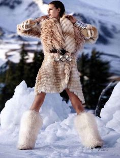 Big furry white yeti boots, I love it!  Luxurious fur coat, ahhh!