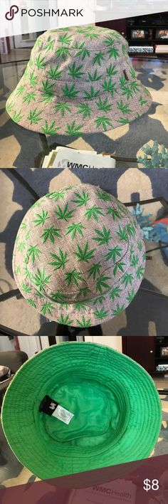 """Bucket Hat Tan Woven bucket hat with green marijuana plants embroidered throughout. Green interior. Excellent quality hat! No flaws! 100% cotton, easily washable. Brand is """"Neon Lights"""". One size fits most. Feel free to ask any questions and make an offer using the offer button! NO TRADES Neon Lights Accessories Hats"""