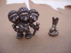 "2 Pewter figurines-snake, Norway on back 3/4"" & 3 headed org guy 1 1/4"" $5"
