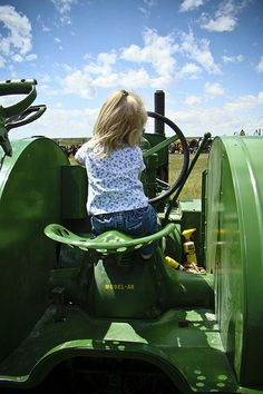 Could be one of our little girls (1962-63) on our John Deere or Oliver tractor. Good thoughts.
