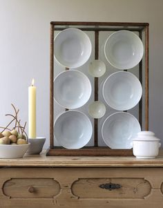 Instant art: Place plain white bowls in a glass display case.    #art #diyprojects