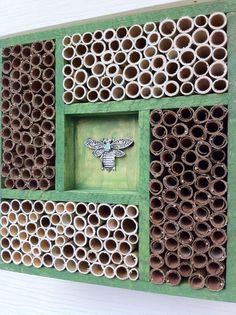 A home for [solitary] Mason Bees: the holes should be as close to of an inch as possible - here, a simple wooden frame contains compartments of Phragmite / reed stems and rolled-up, dried southern magnolia leaves. Garden Insects, Garden Bugs, Garden Animals, Bug Hotel, Mason Bees, Bee House, Beneficial Insects, Natural Garden, Save The Bees