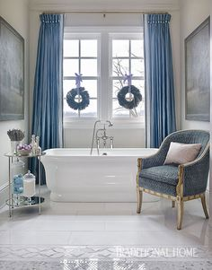 An elegant blue bathroom in a Tennessee home decorated for Christmas
