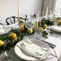 Simple dinner table decor with fresh lemons and eucalyptus.