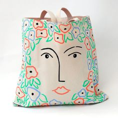 For inspiration on Etsy follow Scaapi - Femme Fleur Tote Bag by PrintMaison on Etsy, $65.00