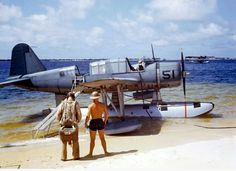 OS2U-3 Kingfisher at NAS Pensacola, Florida, United States, 1942. Consolidated P2Y flying boat in the background.