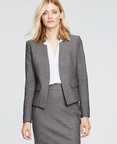 """Our iconic tweed jacket gets a new spin with a refined texture and notched collarless cut. Worn head-to-toe or mixed-and-matched, it's one of the season's most sophisticated looks. Notched lapel. Long sleeves with functional sleeve buttons for added styling options. Front flap besom pockets. Back peplum. Lined. 20"""" long."""