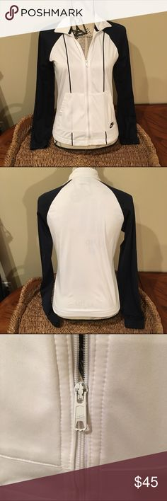 SALE Nike Navy and White Jacket It has been worn, still in great condition. It is a size small and the tag says size small 4-6. It is light weight and perfect for working out or lounging around the house. Nike Jackets & Coats