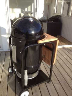 Weber Smokey Mountain Cooker custom table project. I LOVE this design. This is exactly what I need. Now I have to find someone to weld it for me. Volunteers? Plans here...http://tvwbb.com/showthread.php?39760-My-version-of-a-wsm-table&p=434256&viewfull=1#post434256