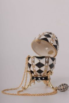 Black and White Faberge Egg with Gold Necklace Inside