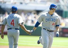 Anthony Rizzo gets congratulations from third base coach Pat Listach at after hitting a home run to give the Cubs a 1-0. 7/25/12