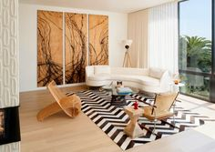 Plenty of wall space was incorporated to house the owner's extensive art collection.*
