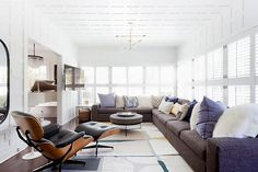Living room with a large gray sectional, and a leather reclining chair