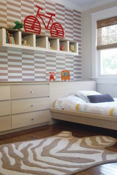 He already has the rug ...    Ikea Malm line of furniture, with bed set flush to chest of drawers and a custom board surface set atop to create built-in feel.