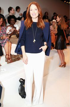 Julianne Moore in a structured blazer, navy sweater and white pants