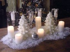 Create a simple, elegant and frosty candle centerpiece with champagne flutes, crystal garland and glass balls to illuminate your winter table.