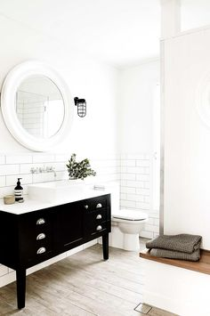 A calm and serene white bathroom