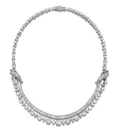 A Diamond Necklace, By Boucheron  The graduated line of alternating brilliant and baguette-cut diamonds suspending a detachable swag of graduated baguette-cut diamonds, can also be separated to form two bracelets, 43.0 cm, with French assay marks for platinum and gold, in beige suede Boucheron pouch Signed Boucheron, no. 59.027 (2)