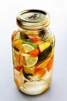 recipe for Citrus-Infused Vodka combines the bounty of winter fruit for a delicious, homemade spirit.  Combine with seltzer for a quick cocktail after it's finished steeping.  It's also delicious on the rocks with a wedge of any of the fruits.  While the flavors infuse, I leave the jar in the middle of my table for a striking and colorful centerpiece.