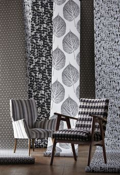 Mix and match statement upholstery  to add pattern and interest to a monochrome scheme - like these chairs covered in fabrics from Harlequin's Momentum 3 and 4 collection (wallpapers from Momentum Wallcoverings Volume 2)