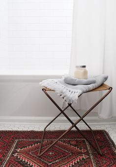 Beautiful style composition with this vintage rug and modern ottoman paired with our lovely Turkish towels on top!