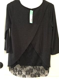Le Lis Berkley Lace Back Knit Top. Like this top. The length looks good, the lace is pretty and can be dressed up for work or paired with jeans for the weekend.