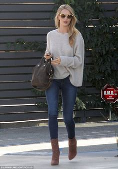 A leggy display: Rosie Huntington-Whiteley caught the eye as she left an office building in West Hollywood on Monday afternoon