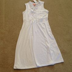 Joe Fresh White cotton dress Dress has ruffle around v-neckline and down center. Empire waistline. 4 rows of double Cotton sheeting on each side at top of dress. Bottom is plain. Add a colorful cardigan or wrap and you're all set. Joe Fresh Dresses Midi