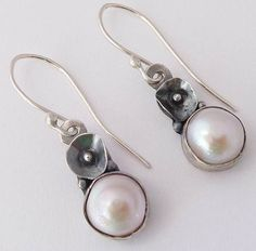 Silver with fresh water pearls and tiny silver flower. €40.00, via Etsy.