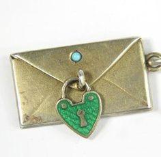 Antique gilt silver envelope with spot of turquoise and enameled padlock • nalfie on eBay http://www.ebay.com/itm/290710159905?ssPageName=STRK:MEWAX:IT&_trksid=p3984.m1438.l2649#ht_1396wt_1413