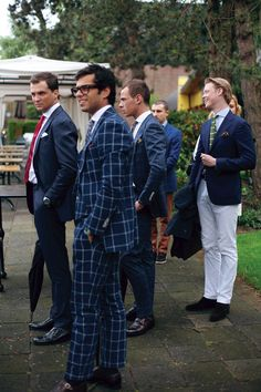 SuitSupply team in Amsterdam style suits windowpane blue .. if you are going to wear windowpane...GO BOLD!