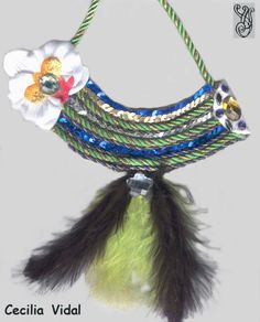 Necklace handmade with felt, beads, feathers, beads and fabric.