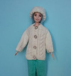 Ravelry: Barbie's Aran pattern by linda Mary Barbie Knitting Patterns, Knitted Doll Patterns, Jumper Knitting Pattern, Knitting Dolls Clothes, Barbie Clothes Patterns, Crochet Doll Clothes, Knitted Dolls, Clothing Patterns, Crochet Patterns