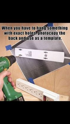 When you have to hang something with exact holes, photocopy it and drill holes where necessary.